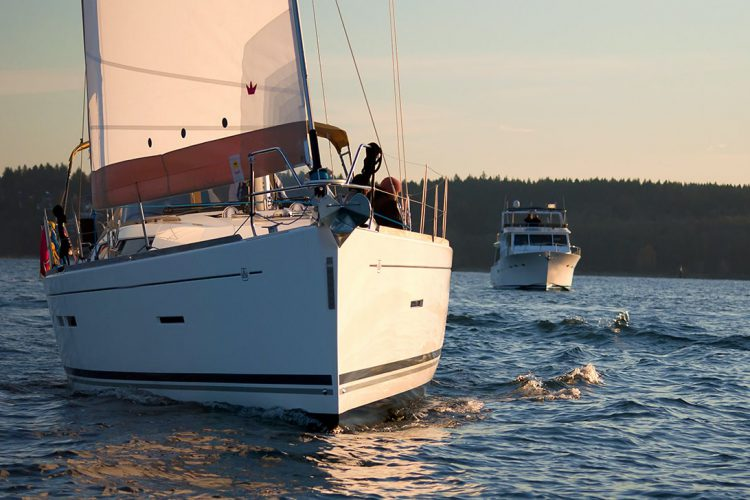 N.Bernard photo                                             NB 11-6618 Sailboat with powerboat in distance at dusk in Vancouver BC